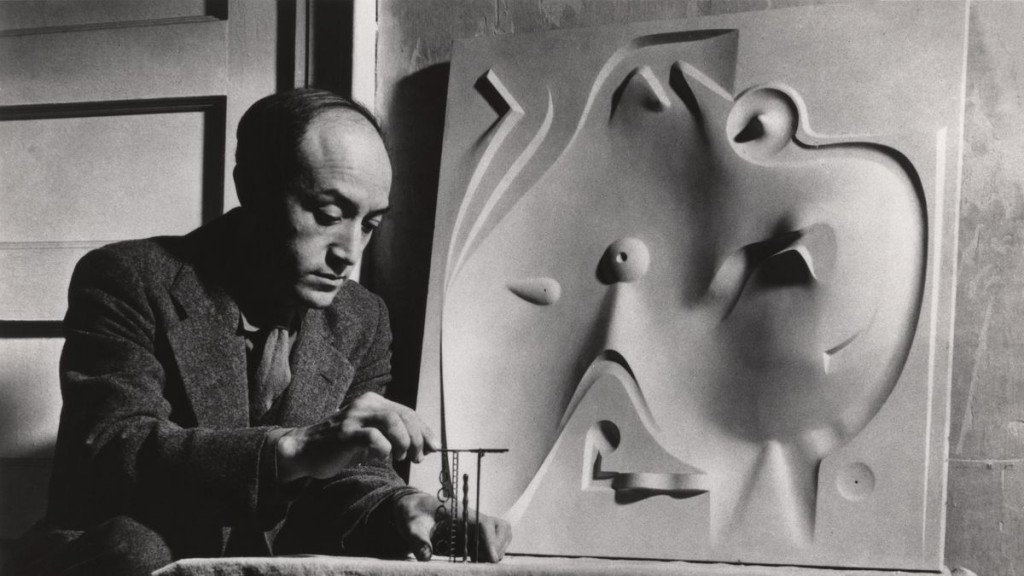 picutre of noguchi working on art piece