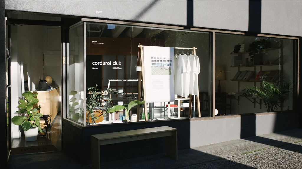 Corduori clubs' first pop up shop at SORT in Kitsilano, Vancouver. Photo fo window display with shirts, plants and other accessories